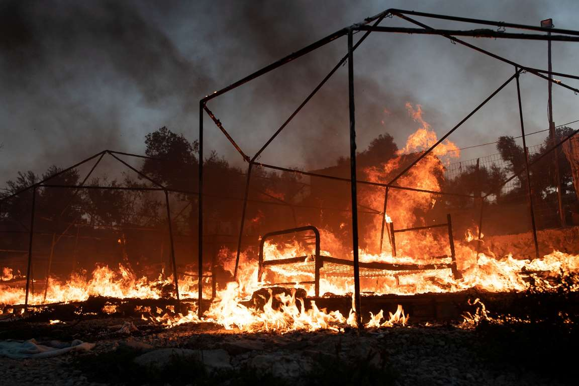 Flames rise as tents burn during a fire at the Moria camp for refugees and migrants on the island of Lesbos, Greece, September 9. REUTERS/Alkis Konstantinidis